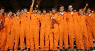 The Orange Jump Suit Guys from the College Kids Tailgate soak up the spirit at the West Virginia game.