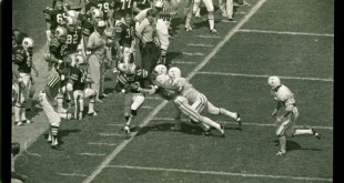 It takes two Vols to handle Gossom in the 1974 Tennessee game, the first ever played in Jordan-Hare.