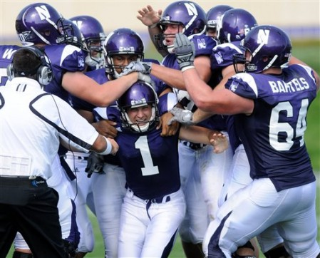 Northwestern players congratulate their starting defensive tackle on a game-saving tackle-for-loss. Just kidding! That guy's the backup.