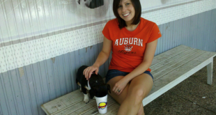 "Nikki Doyle and dog Tiger, partners in ""Booze-Free Dog Treat"" company Drunken Dog, are seen here getting drunk on Auburn Spirit at Toomer's Corner."