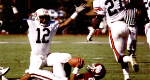 "Corey Barlow and some guy who gave an interview with ""60 Minutes"" (yeah, that's him) celebrate a sack in the 1990 MSU game at Starkville, Miss. (1991 Glomerata)"