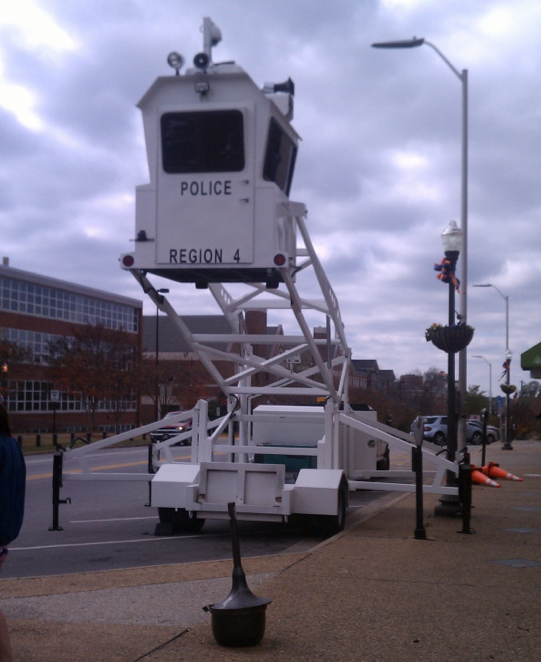 Auburn police stationed a Sky Watch manned mobile surveillance tower equipped with security cameras at Toomer's Corner Wednesday afternoon in preparation for the Iron Bowl this Saturday.