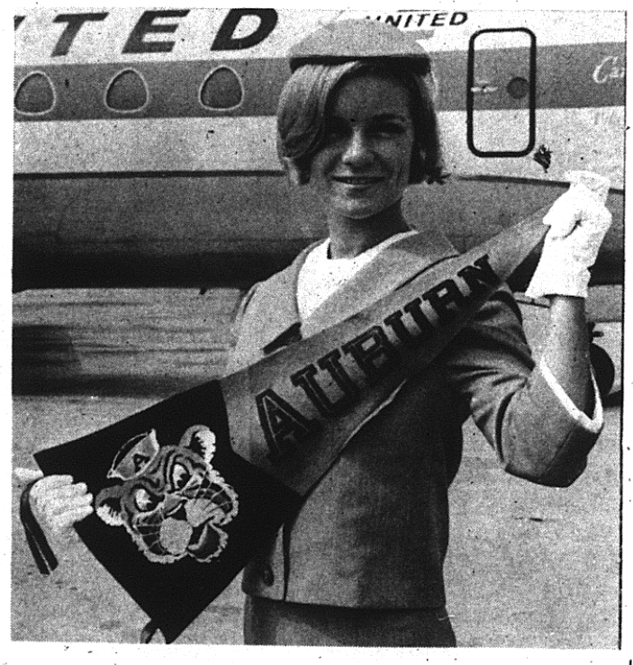 cheerleader works as stewardess with auburn sign crop 9.28.1967