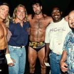 Kevin Greene wearing an Auburn shirt in mid-1990s photo taken with WWF stars