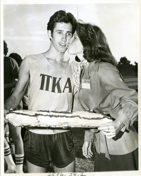 THAT COULD BE YOU, NASHVILLE: Linda Eskind Rebrovick, Music City mayoral candidate, plants the customary congratulatory kiss on the cheek of the 1976 Cake Race winner.