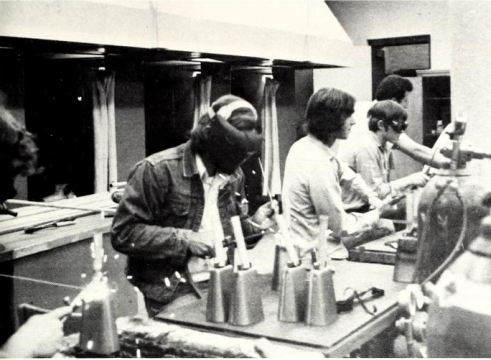 MSU's Industrial Education Association welding hand-friendly handles to cowbells in 1974. (Photo: MSU Reveille)