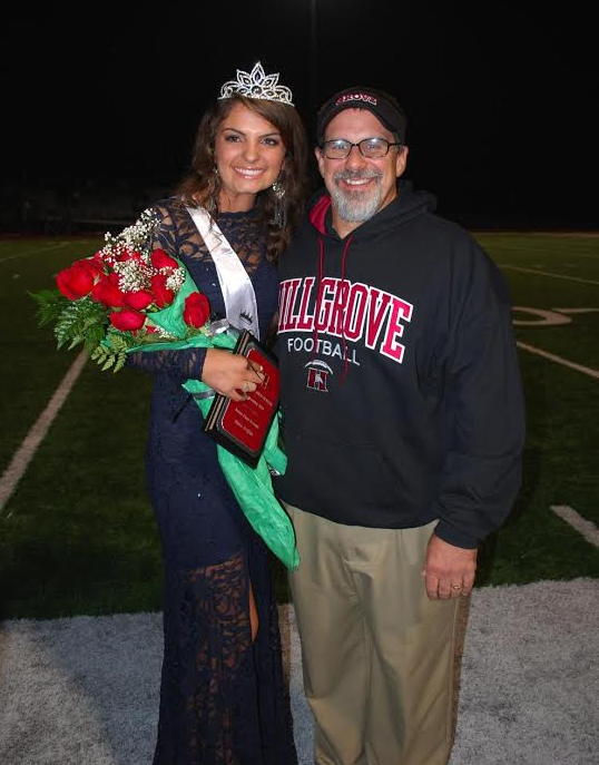 The Homecoming Queen that was Hugging that Man: Auburn fan Mattie Griffith poses with her father Sam Griffith, an assistant football coach at Hillgrove High School (Powder Springs, Ga.), after she was crowned Hillgrove's homecoming queen Friday night. [Photo: Amy Griffith]
