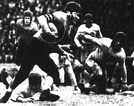 Auburn right halfback Carl Happer gains short yardage against Florida in the first game played in Auburn Stadium. If only there'd been a watch on that wrist...