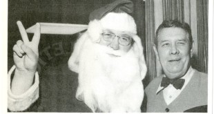 Here's a great Christmas photo of Shug and David Housel (dressed as Santa Claus)