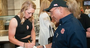 Senior Morgan Estell signs an autograph for a fan. Auburn Softball NCAA Tournament Selection Party and Celebration at Toomer's in Auburn, AL on May 10, 2015.
