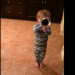 Two-year-old trumpet-wielding Auburn fan marches in time with video of Auburn band every day