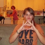 "Alice Fraasa demonstrates the ""AU"" gang sign"
