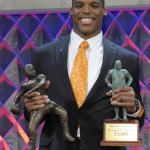 Cam smiles, estimates size of custom trophy case at College Football Awards
