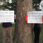 Occupy Herbstreit protest signs made from recycled Toomer's toilet paper; American economy killed by Spike 80DF