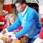 Cam Newton volunteers at Charlotte area food bank, starting children's charity