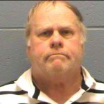 Harvey Updyke arrested on terrorizing charges while returning lawnmower to a Louisiana Lowe's; warrant issued for same charges in Texas