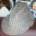 Shug Jordan's houndstooth hat is prized possession of former Auburn coed who caught it after '69 Iron Bowl, claims it predates Bear's