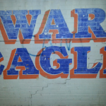 'CAM' graffiti removed from War Eagle wall downtown