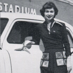 Auburn coed poses with a 1951 Studebaker in front of Cliff Hare Stadium