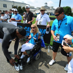 [UPDATED] Fantastic photos of Cam Newton autographing and giving his cleats to a fan after Panthers' practice