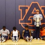 The Auburn basketball team Dufnering with Jason Dufner and his Wanamaker Trophy