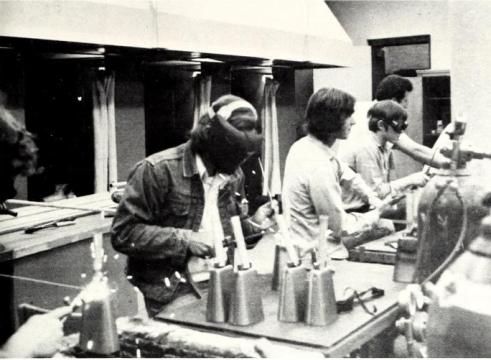 MSU's Industrial Education Association welding hand-friendly handles to cowbells in 1974. (Photo: MSU Reveille)