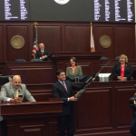 Florida's House of Representatives once again acknowledge Speaker's Auburn loyalty on House floor, this time with an 'Auburn burnt orange' rifle