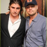 Yet ANOTHER great photo of Leonardo DiCaprio in an Auburn hat (posing with a notorious art dealer)