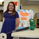 Auburn elementary school student's science project? A Toomer's Corner leaf blower power roller.