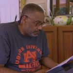 Auburn fan wrongfully on death row for 30 years wears Auburn shirt for '60 Minutes' feature