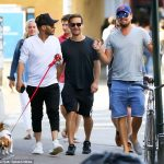 Tobey Maguire hangs out with Leonardo DiCaprio's Auburn hat in New York City